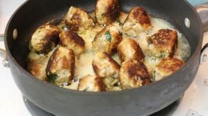 Turkey Meatballs simmering in a pan